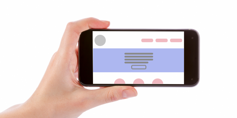 Hand holding a smartphone horizontally with the outline of a mobile app on the screen